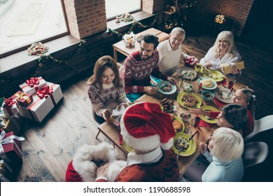 Top above high angle view of noel morning family gathering. Nice adorable cheerful grey-haired grandparents, relatives, sister, brother, son, daughter at feast at lunch table, getting gifts fun joy