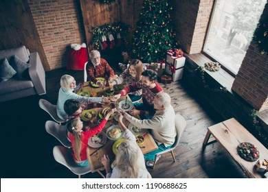 Top above high angle view of noel family meeting, party couple boy gathering. Cheerful grey-haired grandparents, brother, sister, son, daughter at feast, sitting at lunch table, congrats, fun joy tree