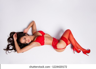 Top above high angle view of nice provocative lovable charming feminine graceful exquisite lovable adorable girl, cool long legs wearing hose, stilettos, isolated over white background