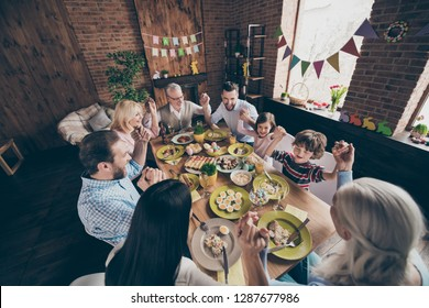 Top above high angle view of nice friendly cheerful positive glad excited family little small brother sister enjoying event party holding hands in decorated loft industrial interior