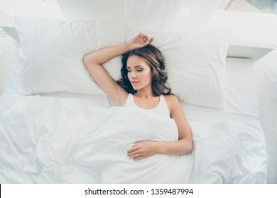 Top above high angle view portrait of her she nice-looking sweet fresh attractive lovable lovely charming cute dreamy wavy-haired lady having rest free time in light white interior room