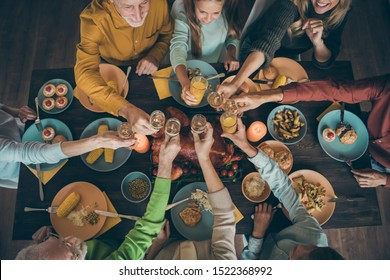 Top above high angle view of nice lovely big full cheerful friendly family having fun lunch eating homemade tasty yummy delicious meal dishes drinking beverage in house restaurant indoors