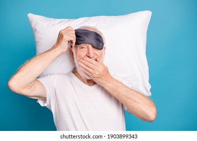 Top above high angle view photo portrait top above high angle of old man laying on pillow yawning isolated on pastel blue colored background