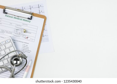 Top or above view, flat lay of physician, professional doctor working table in a hospital, clinical office with patient medical history form, keyboard, heart rate graph, stethoscope, vaccine vial, pen