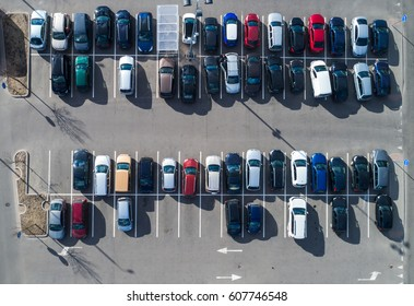 Top aerial view of cars in parking lot