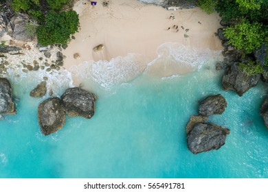 Top Aerial view of impossible Beach in Bali, Indonesia. Empty paradise beach, blue sea waves in Bali island, Indonesia. Drone concept