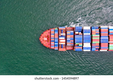 top aerial view of the large volume of TEU containers on ship sailing in the sea carriage the shipment from loading port to destination discharging port, transport and logistics services to worldwide