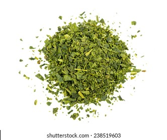Top aerial view of loose leaf green tea isolated on white