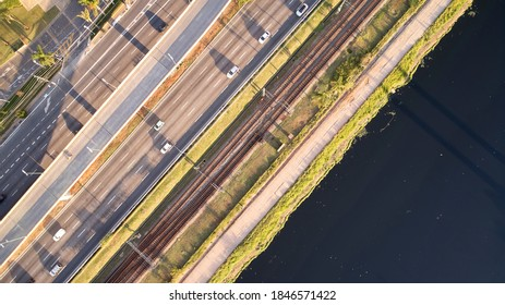 Top aerial view of Marginal Pinheiros expressway and Pinheiros river in Sao Paulo city, Brazil. Traffic with few cars near Estaiada Bridge (Ponte Estaiada) on a sunny day.