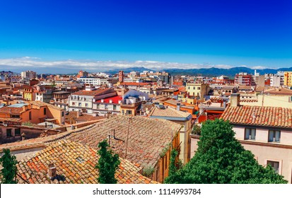 Top aerial view on Girona, Catalonia, Spain. Scenic and colorful ancient town. Famous tourist resort destination, perfect place for holiday and vacation.