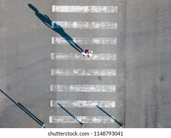 top aerial view of on man walking on the crosswalk in the street, abstract isolated disign with copy space