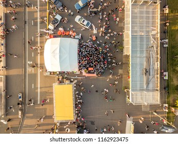 top aerial view of people crowd on the summer fair