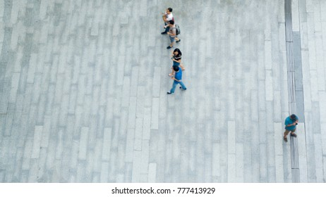 top aerial view of people walk on pedestrian street city