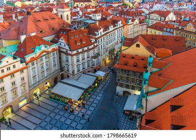 Top aerial view of Prague Old Town (Stare Mesto) historical city centre with red tiled roof buildings on Old Town Square (Staromestske namesti) in evening sunset, Bohemia, Czech Republic