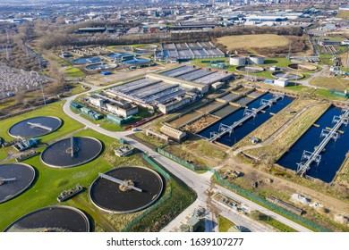Top aerial view of purification tanks of modern wastewater treatment plant, the waste water and sewage treatment plant is located in the town of Leeds in West Yorkshire UK, taken in the winter time.