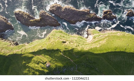 Top aerial view of the shorelines of Mykines islands in Faroe Islands.