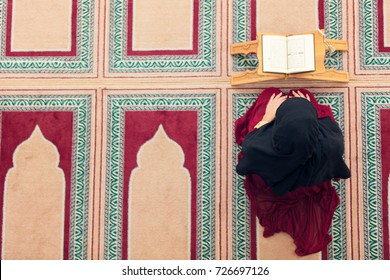Top aerial view Young beautiful Muslim Woman Praying In Mosque