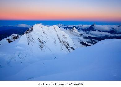 Top Alpine peaks right before sunrise. Wallis Alps in Switzerland, 4500m