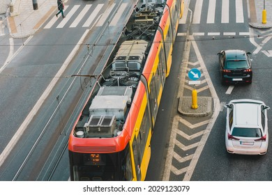 Top angle view of a tram motor mecanism and connection to electricity. Public transportation. Tramway. Transport. Engine. High voltage. Wires. Electric wire