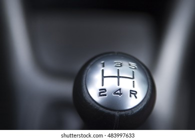 The top of an automotive gear shifter.