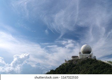 A top ball sattelite on the top of mountain and blue sky