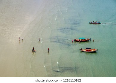 Top of Ban Bang Pu Beach, view of many tourist on the beach with many small boats floating in the sea, traveling to Phraya Nakhon Cave. Prachuap Khiri Khan, Thailand.