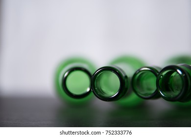 Top of beer bottles on blurred background, closeup.