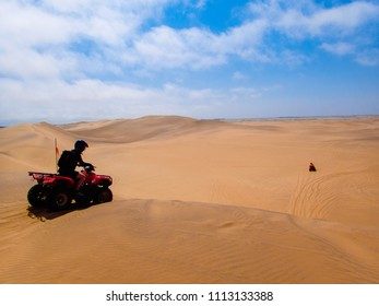 At the top of a big sand dune. Quad biking, Namib Desert, Namibia.