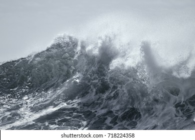 Top of a big stormy sea wave. Toned blue.