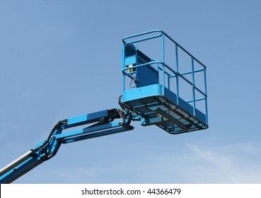 The Top of a Blue Mechanical Lift Vehicle - Cherry Picker.