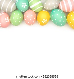 Top border of hand painted pastel Easter eggs over a white background
