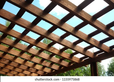 Top of brown wooden pergola on sunny summer day side view outdoor