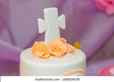 Top of cake with cream flowers and mastic cross for christening child party. Baptism candy bar for girl.