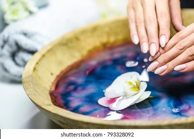Top care manicure. Woman hands care and relaxing.  Nails salon