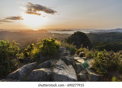 Top of the Castle Rock, Coromandel New Zealand. view from the top, sunset, forest hills, seashore view, ocean and islands.