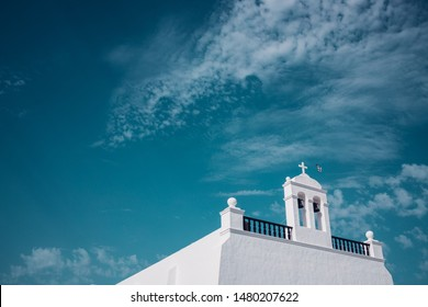 Top of the church of Uga with Bells and dove flying to the cross