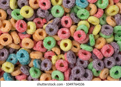 Top close view of generic dry sugar coated fruity flavored breakfast cereal.
