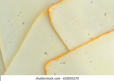 Top close view of muenster cheese slices.