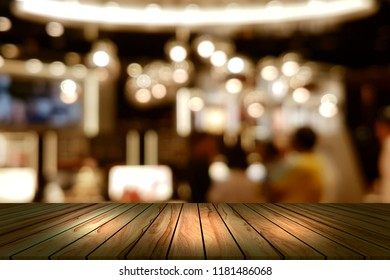 Top desk with blur restaurant background,wooden table