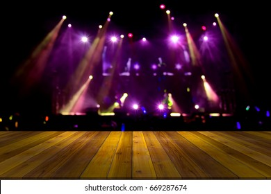 top desk with light bokeh in concert blur background,wooden table