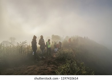 Top of Doi Pha Hom Pok, Fang, Chiang Mai -THAILAND, Jan. 5, 2013 : mountain view misty morning of many tourists standing on top of high mountain around with the mist, sunrise at top of Doi Pha Hom Pok