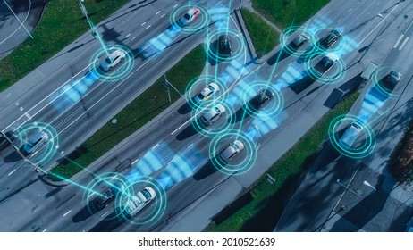 Top Down Aerial Drone: Autonomous Self Driving Cars Moving Through City. Concept: Artificial Intelligence Scans Surrounding Environment, Detecting Cars, Avoids Traffic Jams and Drives Safely.