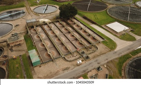 Top down aerial drone image of a sewage treatment plant in Guildford, England.
