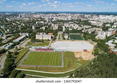 Top down aerial drone image of a Ekaterinburg with stadiums: ready and under construction. Midst of summer, backyard turf grass and trees lush green. Title on board - Ekaterinburg