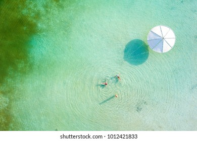 Top down aerial footage of people floating in the salty water of the Dead Sea, Israel.