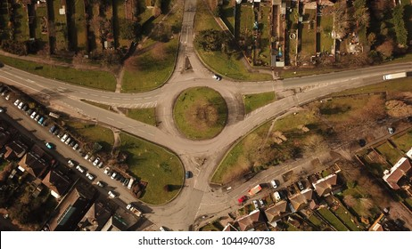 Top down aerial photo of a medium sized roundabout in Guildford, near London, England on a bright sunny day.