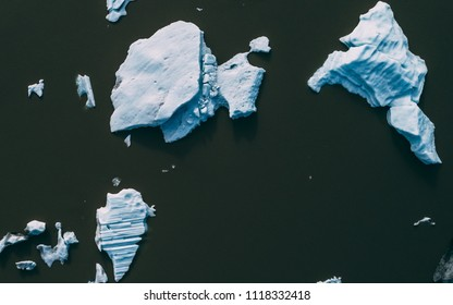 top down aerial shot of icebergs in iceland drone