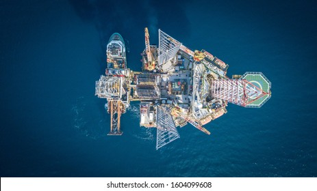 Top down aerial view of a jack up rig in the open ocean captured by drone.