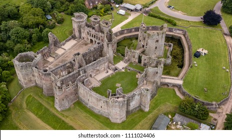 Top down aerial view of the ruins of a large medieval castle (Raglan Castle)