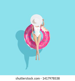 Top down aerial view of summer float doughnut inflatable toy in pool. Summer vacation concept.